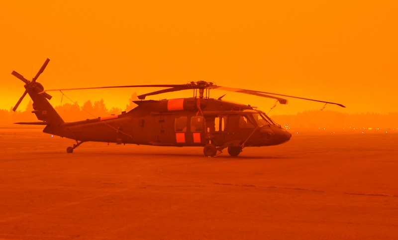Oregon National Guard helicopter against an orange sky